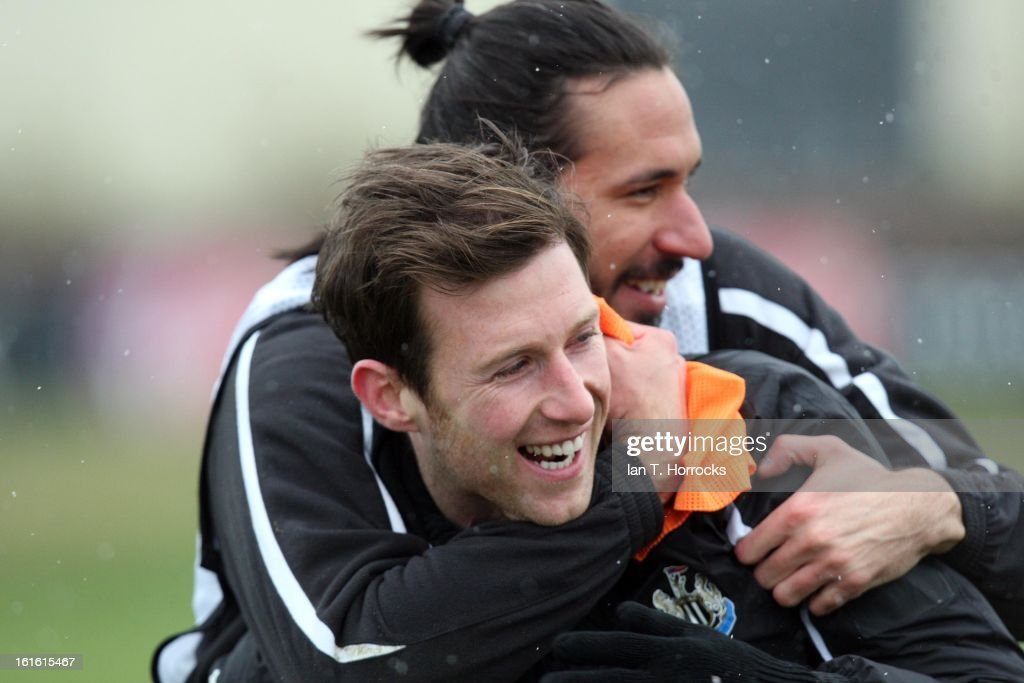 Mike Williamson with Jonas Gutierrez on his back during a Newcastle United Training Session at the Little Benton training ground on February 13, 2013 in Newcastle upon Tyne, England.