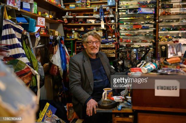 Mike Wollerton, the proprietor of a vintage toy refurbishment and repair business, poses for a photograph inside his shop in the centre of Todmorden,...