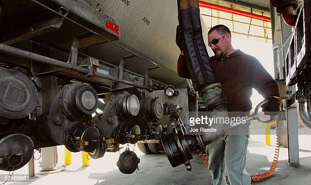 Mike Woods attaches a hose to his delivery truck as he fills up with diesel fuel from the truck rack at the Global Petroleum facility April 27, 2006...
