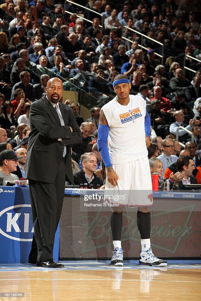 Mike Woodson and Carmelo Anthony #7 of the New York Knicks stand on the sideline during the game against the Detroit Pistons on February 4, 2013 at Madison Square Garden in New York City.