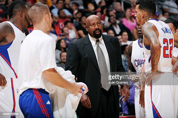 Mike Woodson Assistant Coach of the Los Angeles Clippers speaks to the team during a game against the Golden State Warriors on October 7 2014 at the...