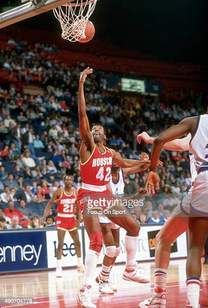 Mike Woodson of the Houston Rockets shoots against the Washington Bullets during an NBA basketball game circa 1990 at the Capital Centre in Landover...
