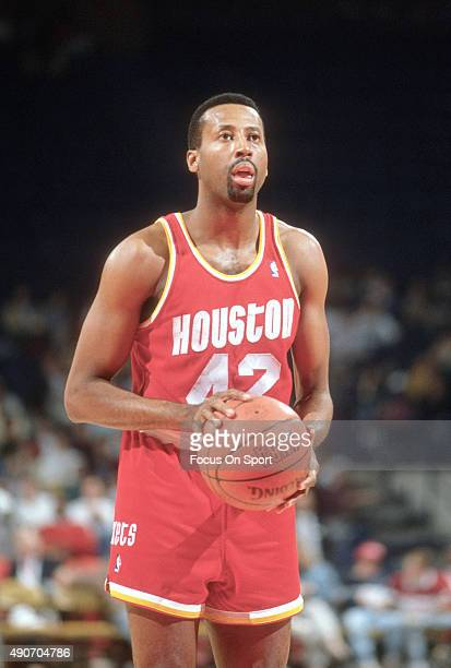 Mike Woodson of the Houston Rockets stands at the line ready to shoot a free throw against the Washington Bullets during an NBA basketball game circa...