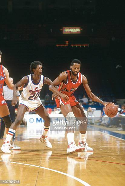Mike Woodson of the Los Angeles Clippers dribbles the ball while being guarded by Steve Colter of the Washington Bullets during an NBA basketball...