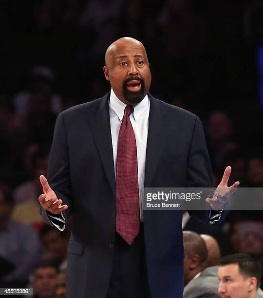 Mike Woodson of the New York Knicks handles bench duties against the Chicago Bulls at Madison Square Garden on December 11 2013 in New York City The...