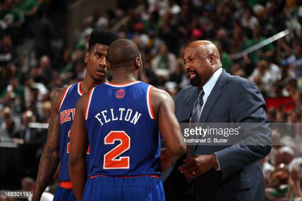 Mike Woodson of the New York Knicks talks with Iman Shumpert and Raymond Felton during the game against the Boston Celtics in Game Four of the...