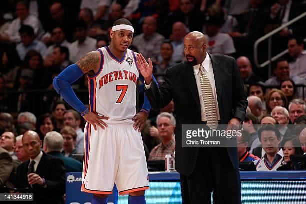 Mike Woodson the interim head coach of the New York Knicks coaches Carmelo Anthony of the New York Knicks during the game against the Portland...
