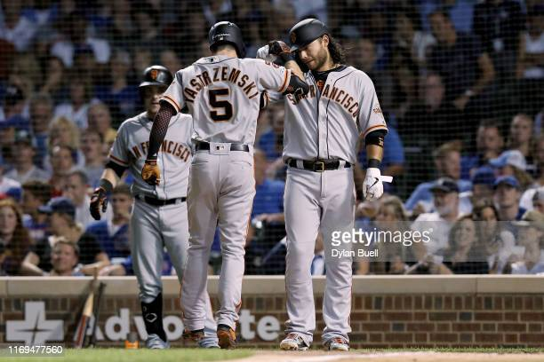 Mike Yastrzemski and Brandon Crawford of the San Francisco Giants celebrate after Yastrzemski hit a home run in the sixth inning against the Chicago...