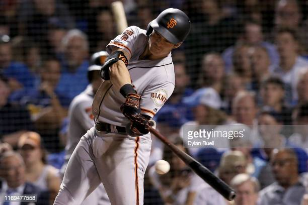 Mike Yastrzemski of the San Francisco Giants hits a home run in the sixth inning against the Chicago Cubs at Wrigley Field on August 21 2019 in...