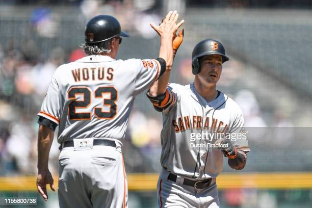 Mike Yastrzemski of the San Francisco Giants is congratulated by Ron Wotus of the San Francisco Giants after hitting a first inning solo homer...
