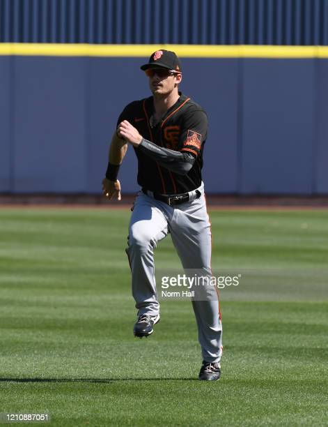 Mike Yastrzemski of the San Francisco Giants prepares for a spring training game against the Milwaukee Brewers at American Family Fields of Phoenix...