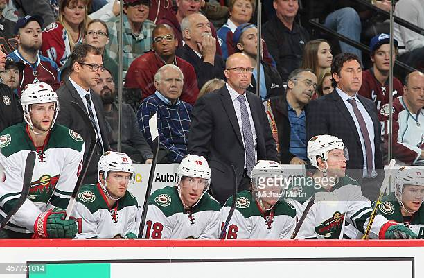 Mike Yeo head coach of the Minnesota Wild looks on during the game against the Colorado Avalanche at the Pepsi Center on October 11 2014 in Denver...