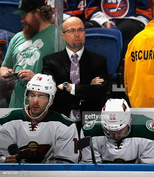 Mike Yeo of the Minnesota Wild handles bench duties against the New York Islanders at the Nassau Veterans Memorial Coliseum on March 24 2015 in...