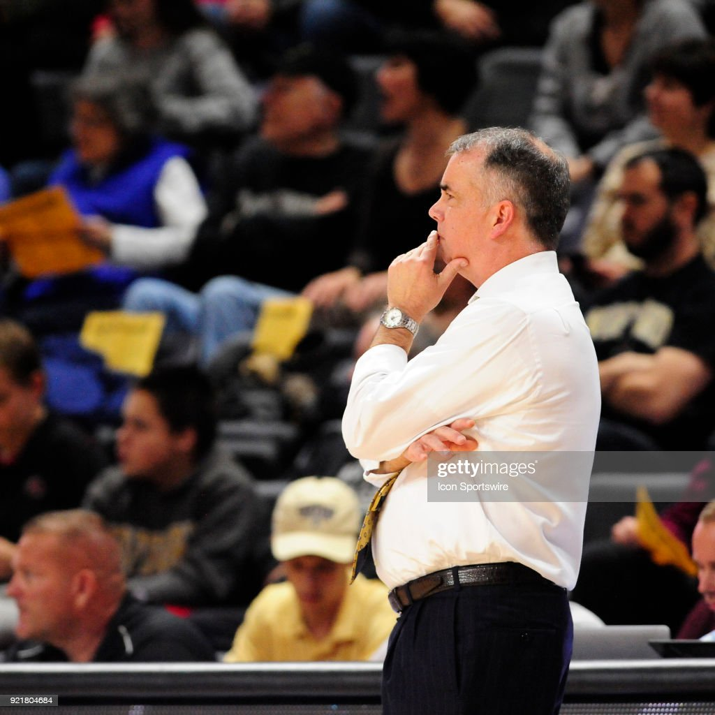 Mike Young head coach Wofford College Terriers studies the offensive and defensive match-ups during the game against the University of North Carolina Greensboro (UNCG) Spartans, Tuesday, February 20, 2018, at Richardson Indoor Stadium in Spartanburg, South Carolina. UNC Greensboro wins 76-66.
