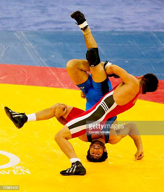 Mike Zadick is flipped on his head by Eric Guerrero in the Men's Freestyle 55 KG Final Match 1 during the 2004 Olympic Team Trials of Wrestling at...