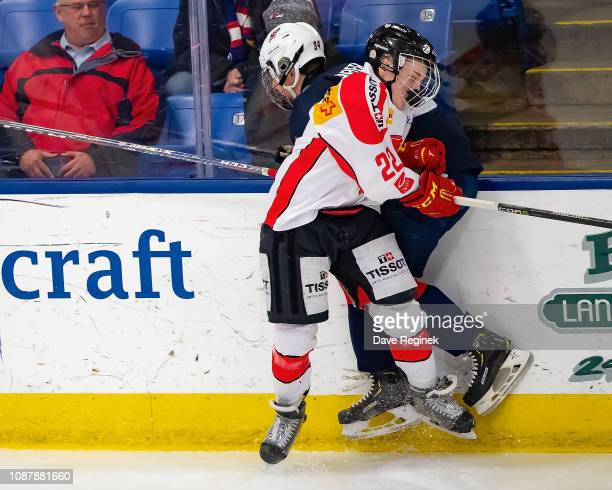 Mike Zaugg of the Switzerland Nationals body checks Brock Faber of the US Nationals during day2 of game two of the 2018 Under17 Four Nations...