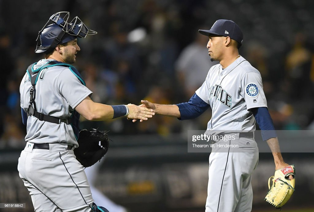 Mike Zunino #3 and Edwin Diaz #39 of the Seattle Mariners celebrates defeating the Oakland Athletics 1-0 at the Oakland Alameda Coliseum on May 23, 2018 in Oakland, California.