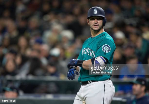 Mike Zunino of the Seattle Mariners adjusts his batting gloves before an atbat during a game against the Texas Rangers at Safeco Field on April 14...