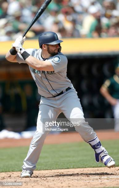 Mike Zunino of the Seattle Mariners bats during the game against the Oakland Athletics at the Oakland Alameda Coliseum on August 15 2018 in Oakland...