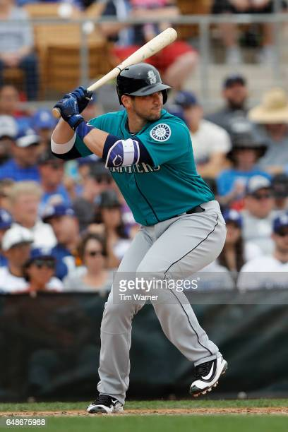 Mike Zunino of the Seattle Mariners bats in the sixth inning against the Los Angeles Dodgers during the spring training game at Camelback Ranch on...