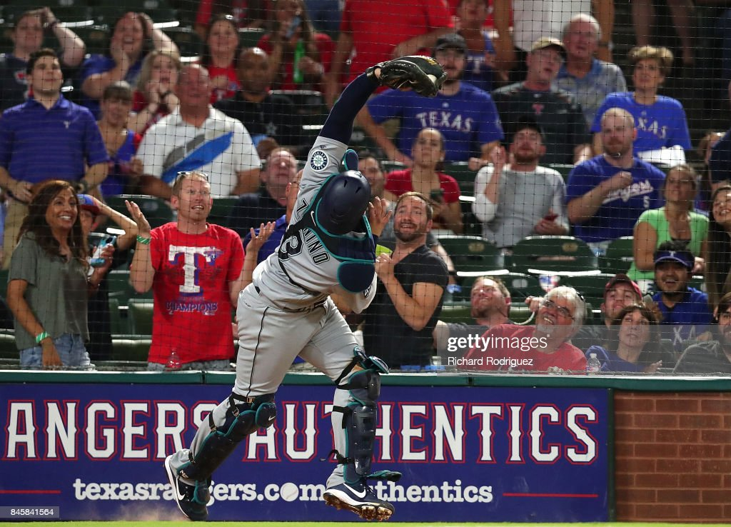 Mike Zunino #3 of the Seattle Mariners catches a foul ball by Rougned Odor #12 of the Texas Rangers in the sixth inning of a game at Globe Life Park in Arlington on September 11, 2017 in Arlington, Texas.