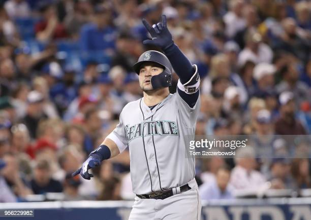 Mike Zunino of the Seattle Mariners celebrates after hitting a tworun home run in the fourth inning during MLB game action against the Toronto Blue...