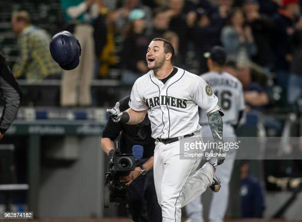 Mike Zunino of the Seattle Mariners celebrates as he rounds the bases after hitting a solo home run off of relief pitcher Matt Magill of the...