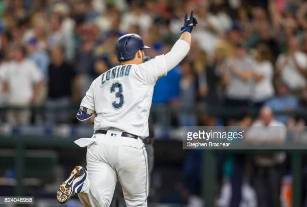 Mike Zunino of the Seattle Mariners celebrates hitting a home run during a game against the Boston Red Sox at Safeco Field on July 25 2017 in Seattle...