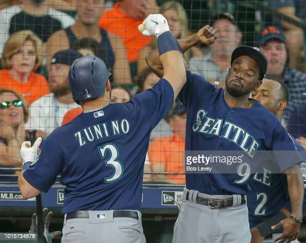 Mike Zunino of the Seattle Mariners celebrates with Dee Gordon after hitting a home run in the seventh inning against the Houston Astros at Minute...