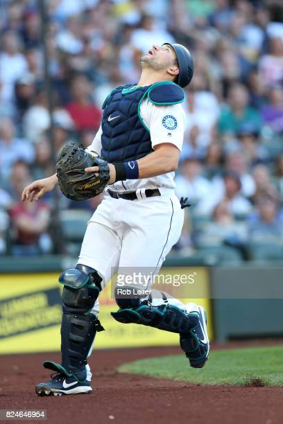 Mike Zunino of the Seattle Mariners chases a pop up during the game against the New York Yankees at Safeco Field on July 22 2017 in Seattle...