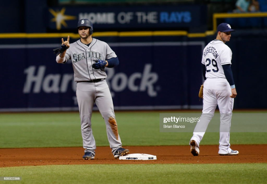 Mike Zunino #3 of the Seattle Mariners gestures back to the dugout in front of second baseman Daniel Robertson #29 of the Tampa Bay Rays after hitting a two-run double during the fourth inning of a game on August 18, 2017 at Tropicana Field in St. Petersburg, Florida.