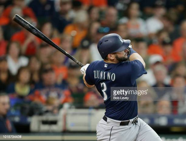 Mike Zunino of the Seattle Mariners hits a home run in the seventh inning against the Houston Astros at Minute Maid Park on August 12 2018 in Houston...
