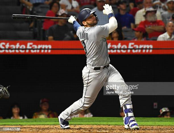 Mike Zunino of the Seattle Mariners hits a solo home run in the fifth inning against the Los Angeles Angels of Anaheim at Angel Stadium on July 27...
