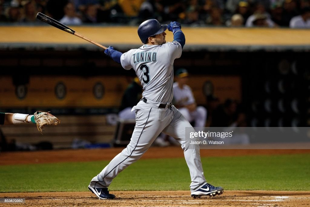 Mike Zunino #3 of the Seattle Mariners hits a three run home run against the Oakland Athletics during the second inning at the Oakland Coliseum on September 25, 2017 in Oakland, California.