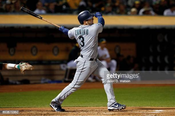 Mike Zunino of the Seattle Mariners hits a three run home run against the Oakland Athletics during the second inning at the Oakland Coliseum on...