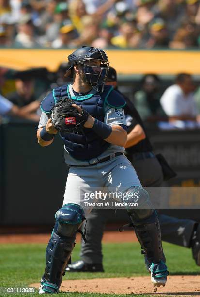 Mike Zunino of the Seattle Mariners in action against the Oakland Athletics in the bottom of the six inning at Oakland Alameda Coliseum on September...