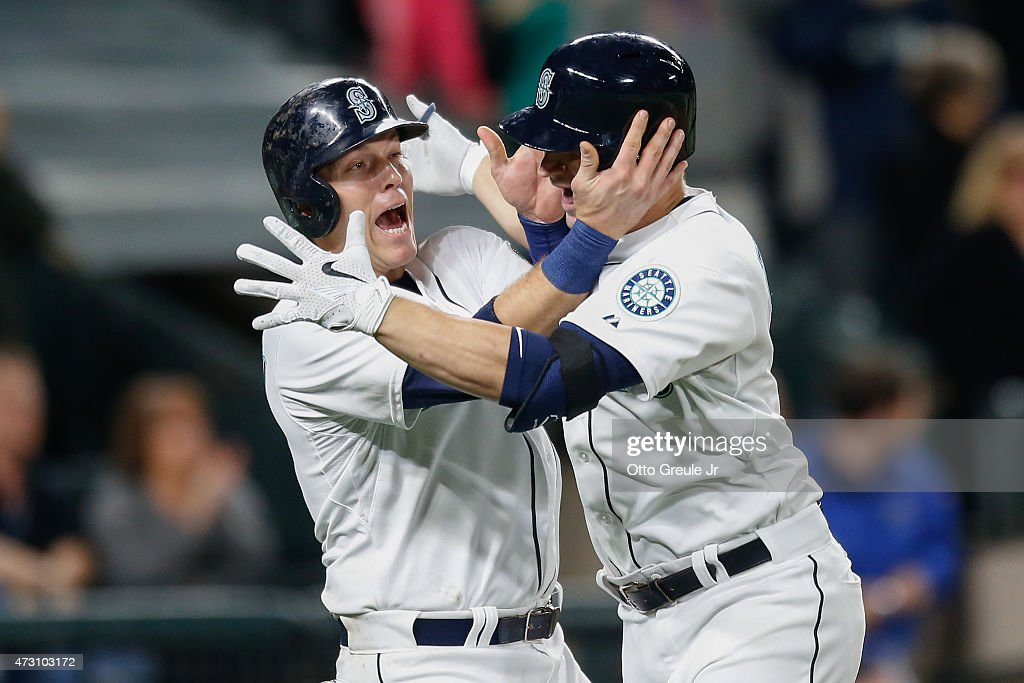 Mike Zunino #3 (R) of the Seattle Mariners is congratulated by Logan Morrison #20 after hitting a two-run homer against the San Diego Padres in the seventh inning at Safeco Field on May 12, 2015 in Seattle, Washington.