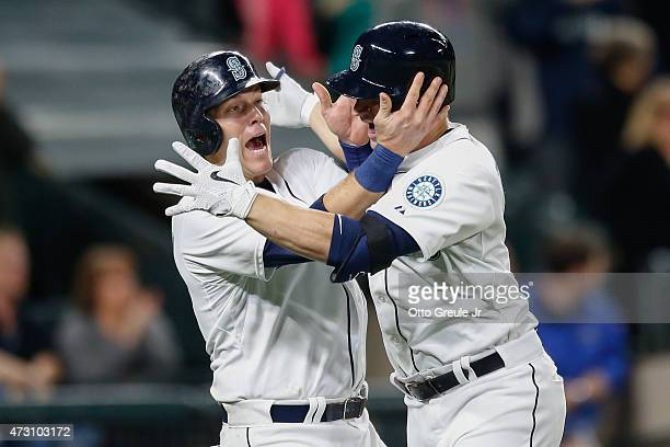 Mike Zunino of the Seattle Mariners is congratulated by Logan Morrison after hitting a tworun homer against the San Diego Padres in the seventh...