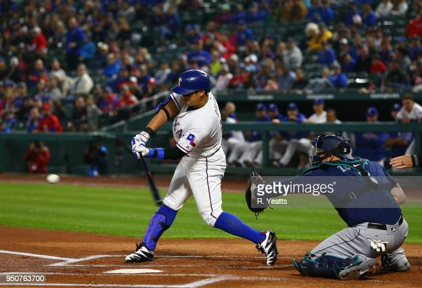 Mike Zunino of the Seattle Mariners looks on as ShinSoo Choo of the Texas Rangers hits in the first inning against at Globe Life Park in Arlington on...