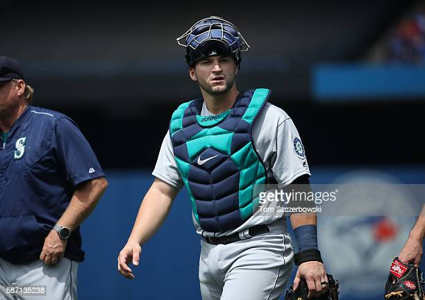Mike Zunino of the Seattle Mariners makes his way from the bullpen to the dugout before the start of MLB game action against the Toronto Blue Jays on...