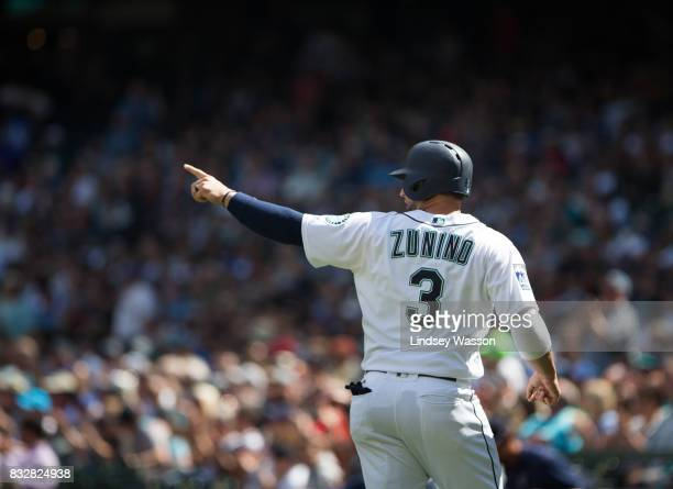 Mike Zunino of the Seattle Mariners points at Guillermo Heredia after he scored on Heredia's double against the Baltimore Orioles in the third inning...