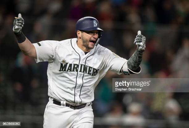 Mike Zunino of the Seattle Mariners reacts after hitting a walk off solo home run off of relief pitcher Matt Magill of the Minnesota Twins during the...