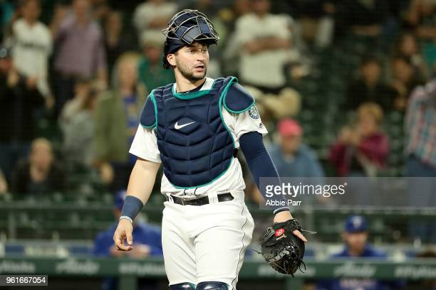 Mike Zunino of the Seattle Mariners reacts in the ninth inning against the Texas Rangers during their game at Safeco Field on May 15 2018 in Seattle...