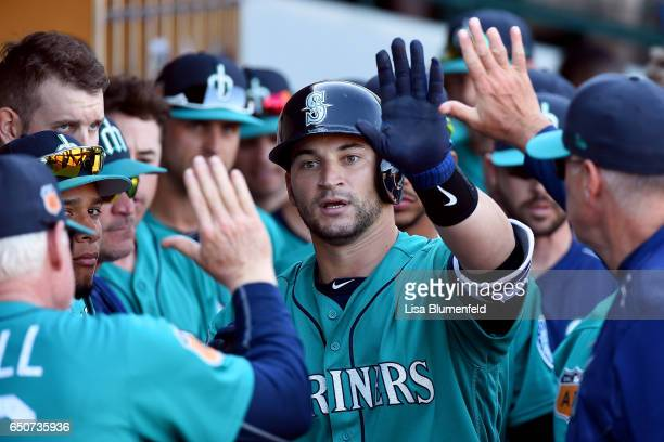 Mike Zunino of the Seattle Mariners returns to the dugout after hitting a homerun against the Chicago Cubs during a spring training game on March 9...