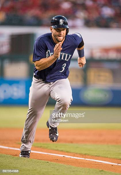 Mike Zunino of the Seattle Mariners runs while scoring on a RBI single by Ketel Marte during the second inning of the game against the Los Angeles...