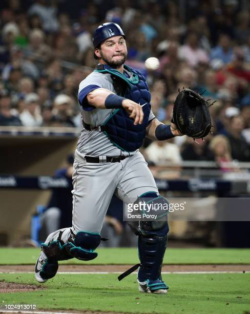 Mike Zunino of the Seattle Mariners throws out Travis Jankowski of the San Diego Padres during the fiifth inning of a baseball game at PETCO Park on...