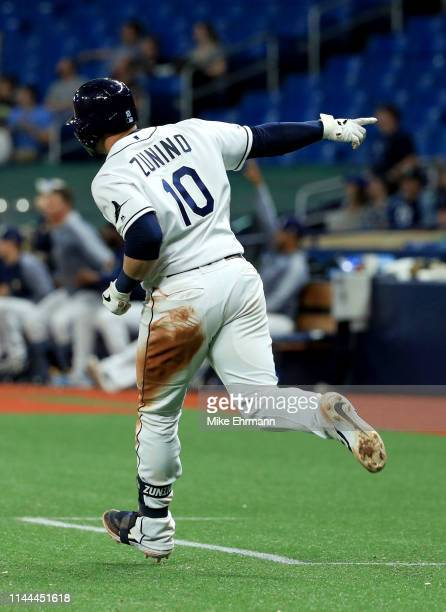 Mike Zunino of the Tampa Bay Rays celebrates a two run home run in the seventh inning during a game against the Kansas City Royals at Tropicana Field...