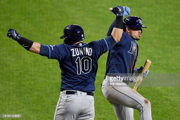 Mike Zunino of the Tampa Bay Rays celebrates with teammate Willy Adames after hitting a two-run home run against the Baltimore Orioles during the...