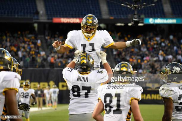 MikeBercovici of the San Diego Fleet celebrates with teammates after throwing a touchdown pass during the third quarter against the Birmingham Iron...