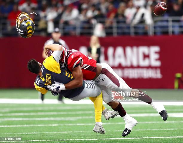 Mike Bercovici of the San Diego Fleet loses his helmet as he is tackled by Shaan Washington of the San Antonio Commanders during the first quarter in...